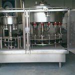 Machine de remplissage de bouteilles de parfum à pression négative à 10 têtes